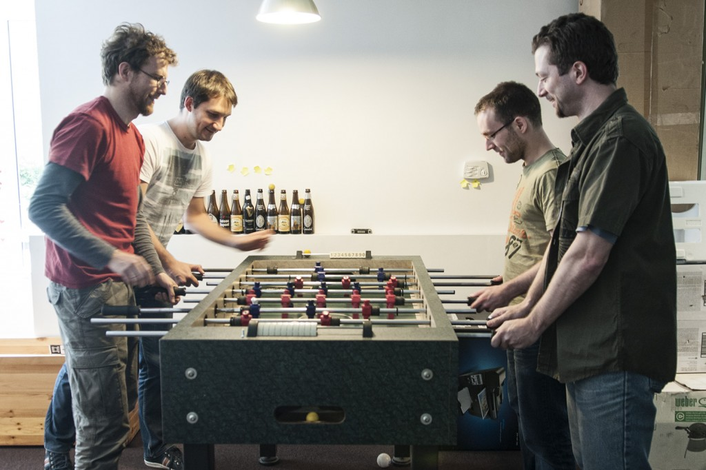 Zoltan playing table football with some friends from work.
