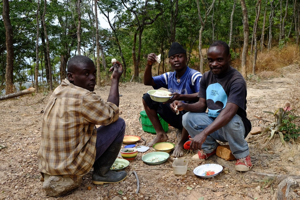 Budget enjoying a typical lunch with his co-workers. Nsima with fish! (Nsima, made from maize flour, is the most popular dish in Malawi)