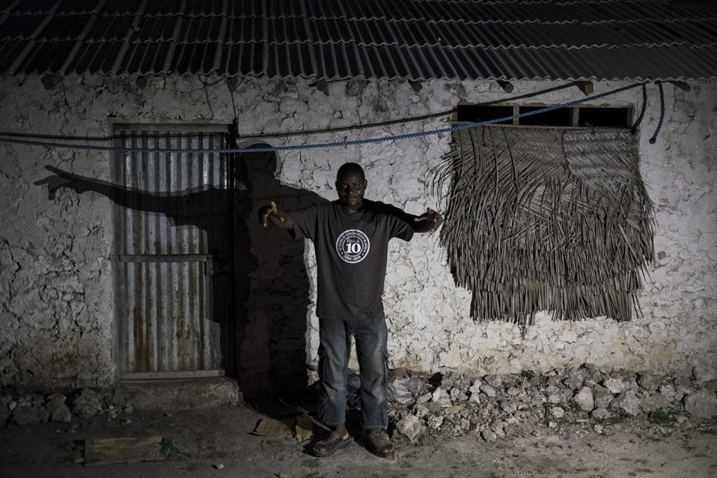 Mmadi in front of his house that he built himself, stone after stone.