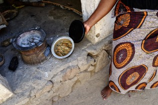 Beatrice preparing a very common dish in Malawi: fish with nsima.