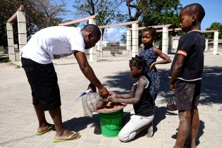 Faruk buying peanuts on the streets of his island from children.