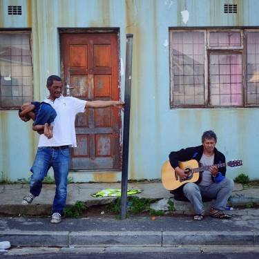 Day 57 – South Africa – Cape Town –Father and son dancing to the sound of a guitar player in the woodstock neibourghood.