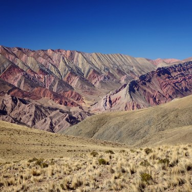 Day 70 – Argentina – Humahuaca – After a few hours driving through a sand track from Humahuaca, the rewarding 14 colors moutain amazed us.