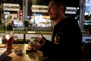 Kevin having a boerewors roll (typical South African dish) in a restaurant in downtown Cape Town.