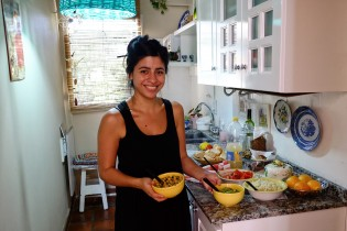 Ines preparing lucnh in her kitchen.