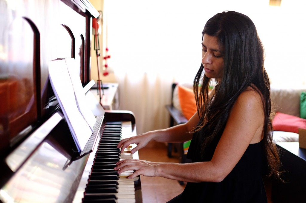 Ines works mainly from her place as a music and piano teacher.
