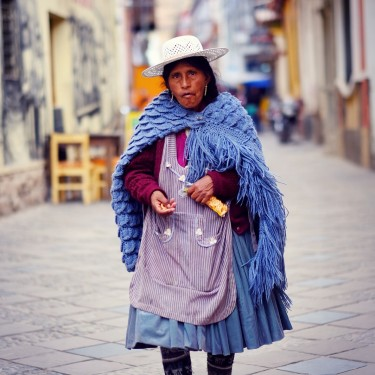 Day 84 – Bolivia – Potosi – Woman wearing typical Bolivian clothes and one of these beautiful hats walking in the streets of the city of Potosi