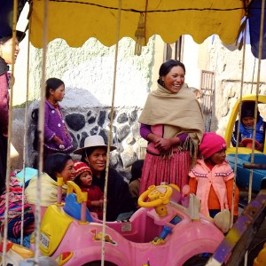 Day 86 – Bolivia – Potosi – Families bringing their child to some roundabout in a festival in Potosi
