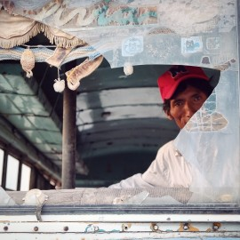 Day 81 – Bolivia – San Juan – Even if we saw amazing Lagunas, the stone tree and beautiful landscapes, we decided to share this picture of a drunk man playing in an abandoned bus in San Juan.