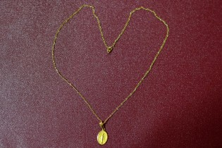 Poala's object his her necklace... that supported her during her whole life