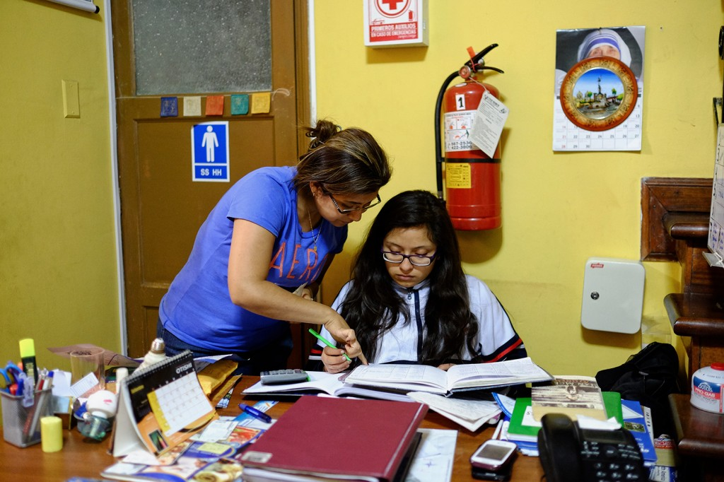 Paola helping her niece with her homework.