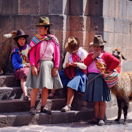 Day 99 – Peru – Cusco – Women wearing a typical Peruvian costume walking around with their Lamas.