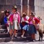 Day 99 – Peru – Cusco – Women wearing a typical Peruvian costume walking around with their Lamas.