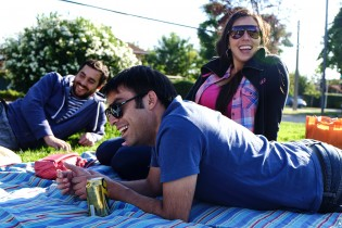Alvaro and some friends (including his partner Ximena) relaxing at a park nearby his apartment.