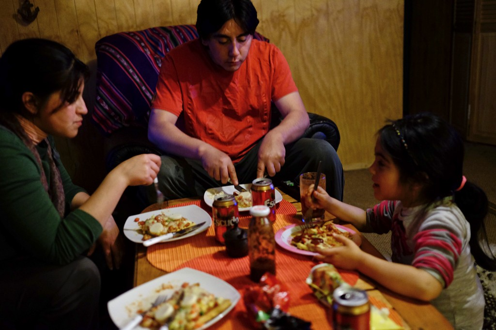 Cristian having dinner with his second daughter and his partner.