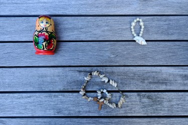 Maria choose 3 objetcs : 1) A russian doll that reminds her origins. 2) A shell necklace with a cross that her fiancé made for her. 3) The pearl bracelet is a symbol of her family since it is from her sister's wedding.