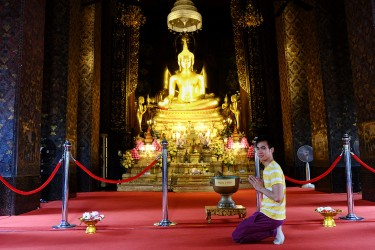 Jay praying at a Buddhist temple in Bangkok.