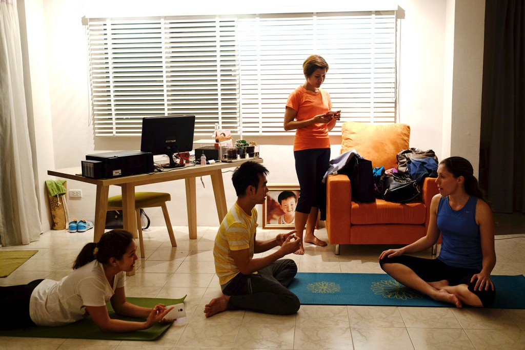 Kornnatt (Jay), giving a Yoga class in Bangkok.