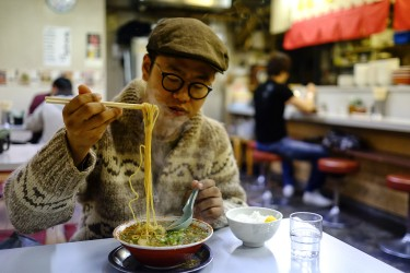 Satoshi having his favorite dish, Ramen! A typical japanese dish!