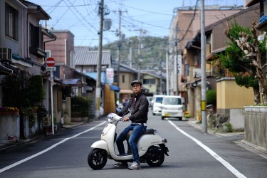 Satoshi mainly uses his scooter to get around in Kyoto.