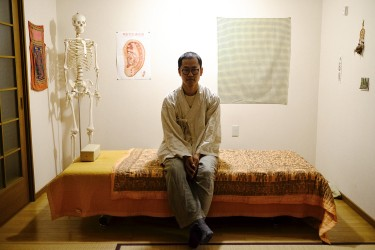 Satoshi works as a Sei-Tai therapist. His therapy room is located in his apartment.