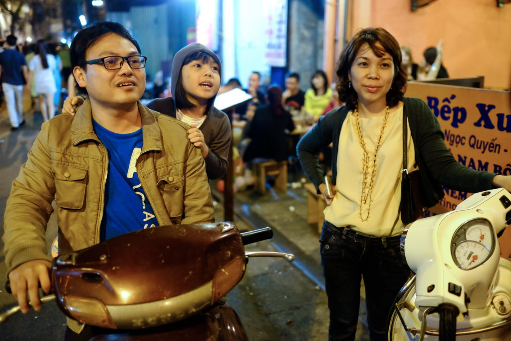 Tung, her husband and her older daughter in the center of Hanoi.