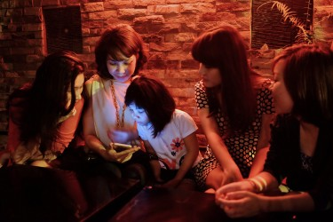 Tung having drinks with friends in a bar located in Central Hanoi.