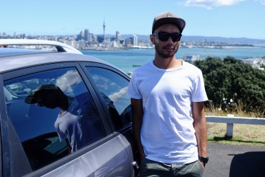 Anousith drives his car around Auckland.
