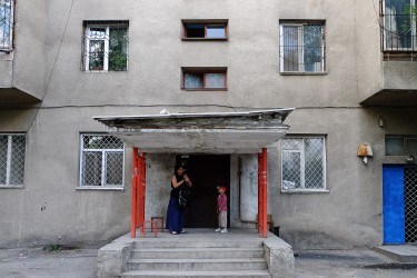 Jibiek lives in this building with her son and her mother.