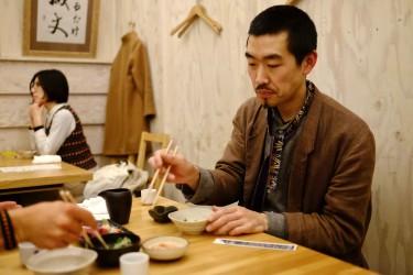 Yohei having dinner at a japanese restaurant.