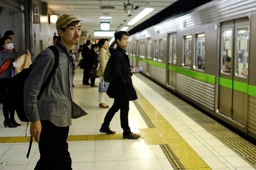 Yohei has many little jobs which never are located at the same place and uses Subway to get around.