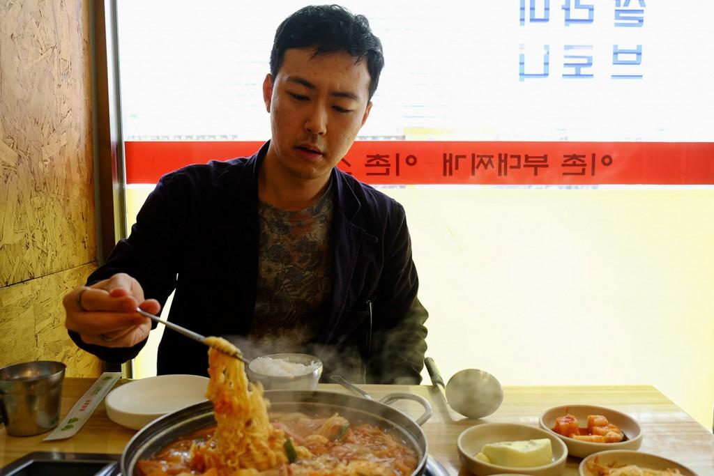 Jun Ho having lunch in a Korean restaurant.