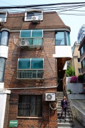 Jun Ho lives on the second floor of this apartment located in the Gangnam district of Seoul.