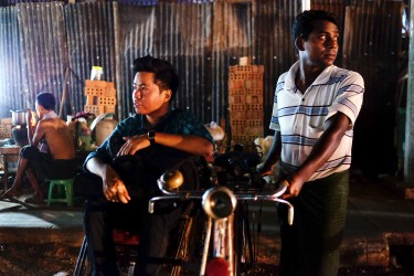 Min taking a rickshaw (tuk tuk) to get home.
