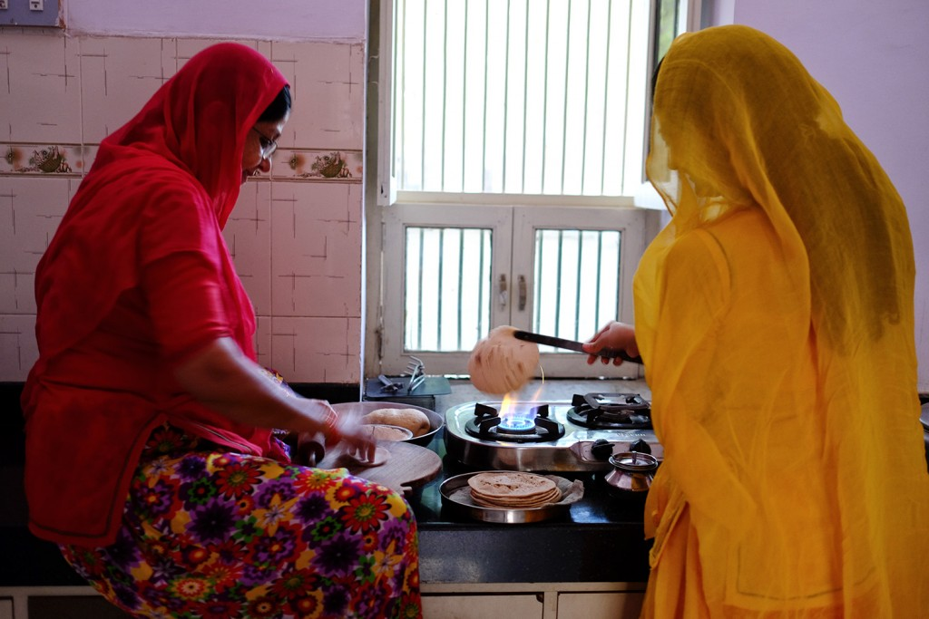 Prerana cooking chapati with her mother in law.