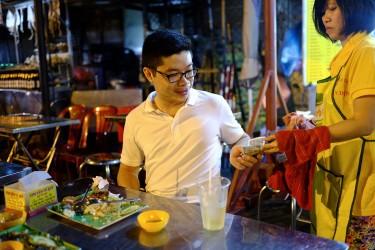 Tu loves food an restaurants. Here he his having some street food.