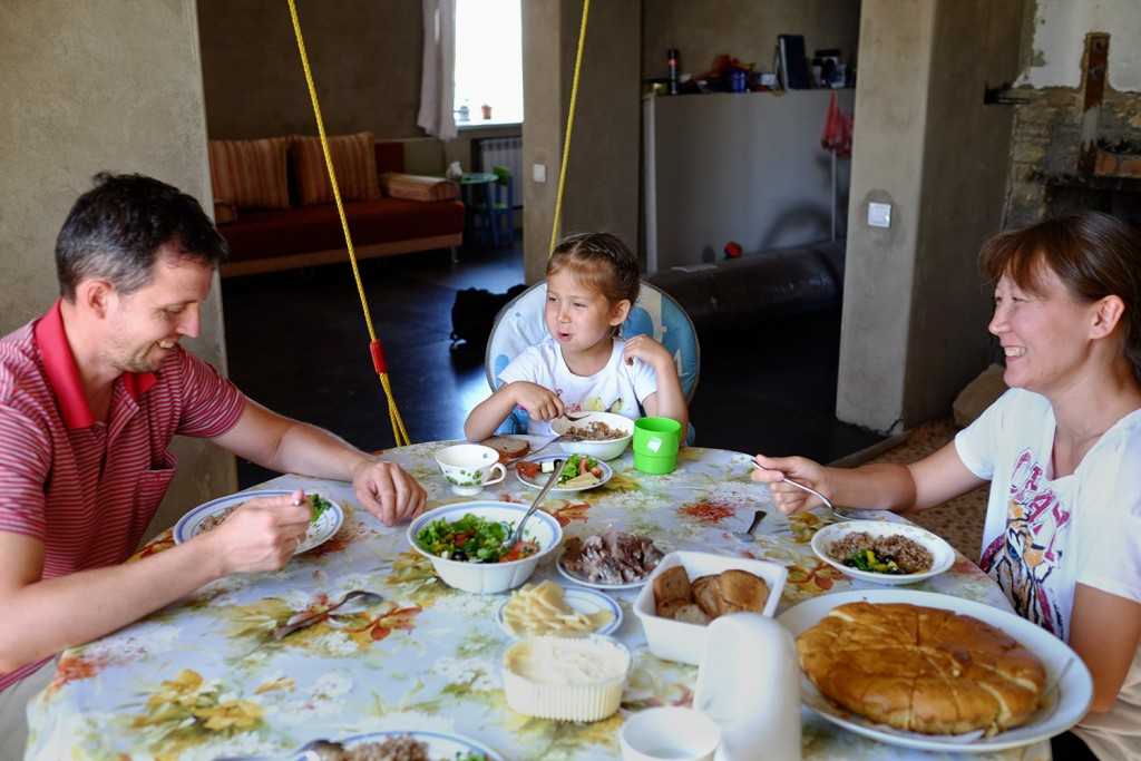Lazzat having lunch with her husband and daughter